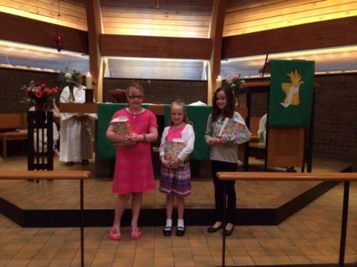 3rd & 4th graders receive Bibles.