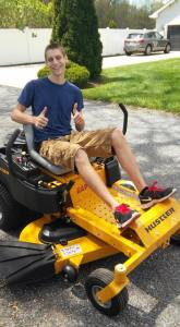 Sam on the new lawnmower